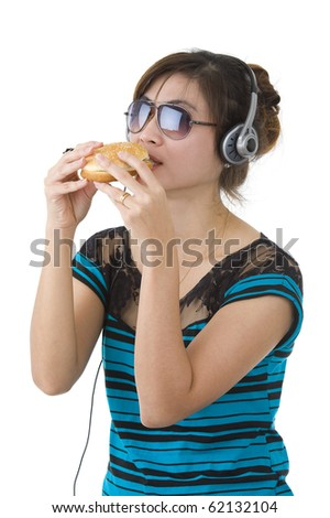 pretty woman with hamburger, sunglasses and head phones over white - stock photo