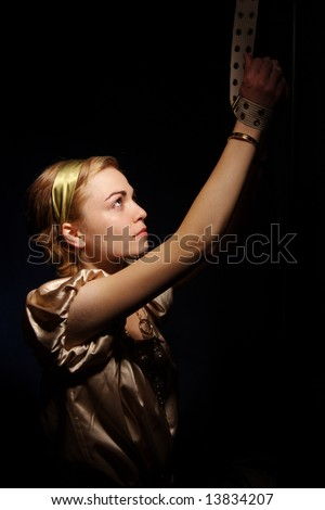 Pretty woman with her hands tied portrait on black background - stock photo