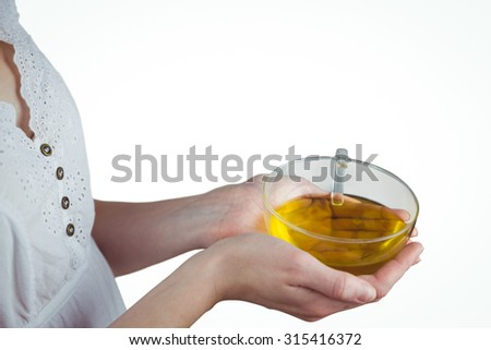 Pretty woman with herbal tea on white background