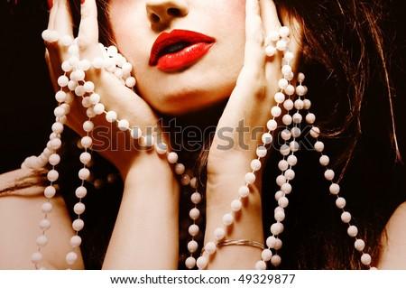 Pretty woman with jewelry - stock photo