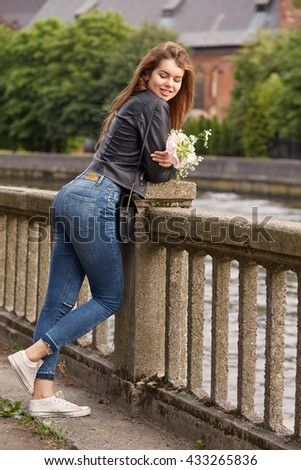 pretty woman with red hair looking over shoulder