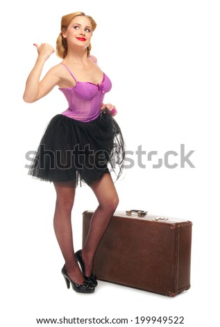Pretty woman with suitcase isolated