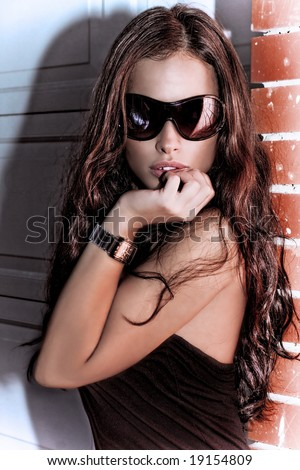 pretty woman with sunglasses, outdoor shot - stock photo