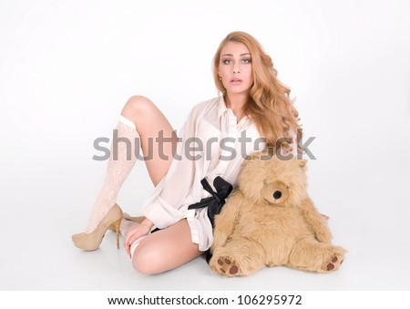 Pretty woman with sweet toy, sit and request - stock photo