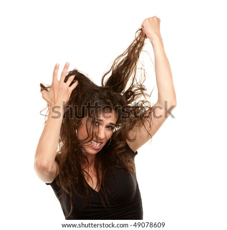 Pretty woman with wild brunette hair on white background - stock photo