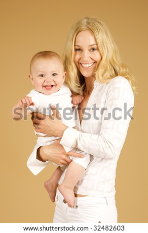 Pretty Women holding cute little girl with two front teeth