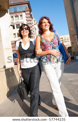 Pretty women walking down the street