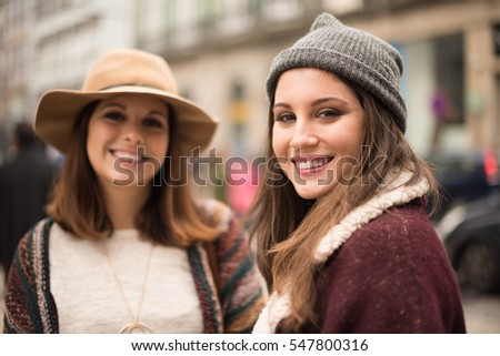 Pretty women wearing winter clothes on the city street