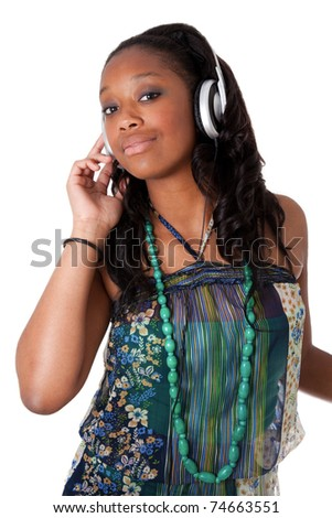 Pretty young african american girl listening music - stock photo