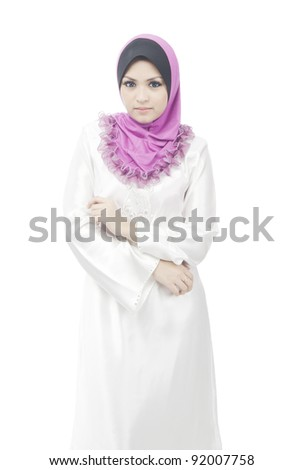 Pretty young Asian Muslim woman stand up while smile in action. - stock photo