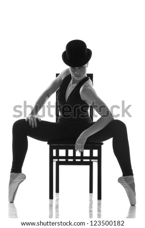 pretty young ballerina sitting on the chair. Isolated on white - stock photo