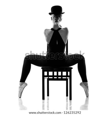 pretty young ballerina sitting on the chair. Rear view. Isolated on white - stock photo