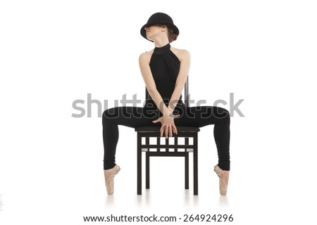 Pretty young ballerina with chair. Isolated on white - stock photo
