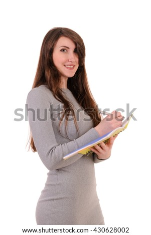 Pretty young beautiful woman standing, writing, take notes, holding  textbook notebook organizer in