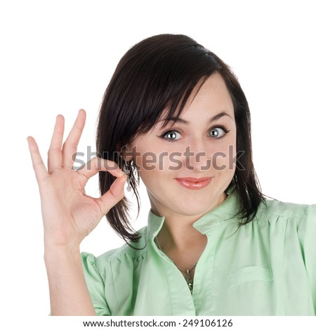 pretty young blond girl showing ok sign - stock photo