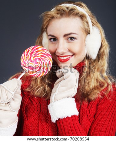 Pretty young blond woman holding lollypop