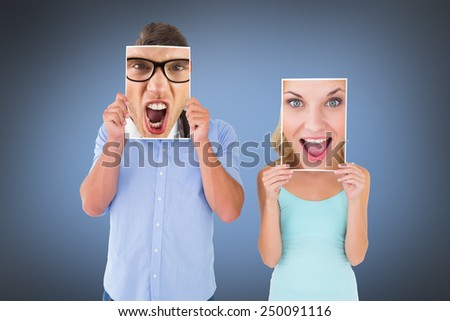 Pretty young blonde feeling surprised against grey vignette - stock photo