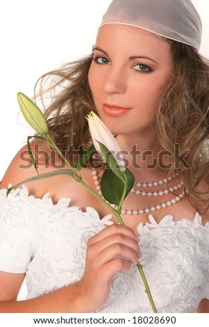 Pretty Young Bride Holding a Lilly on White Background - stock photo
