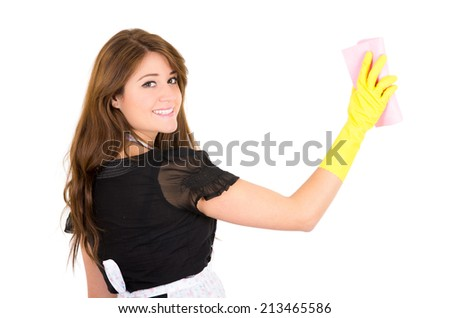 Pretty young brunette girl cleaning blank space wearing gloves isolated on white