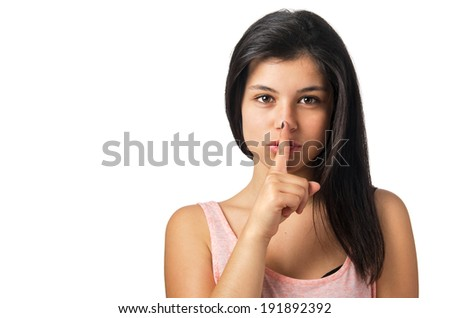 Pretty young brunette girl with finger over mouth in a silence sign - stock photo