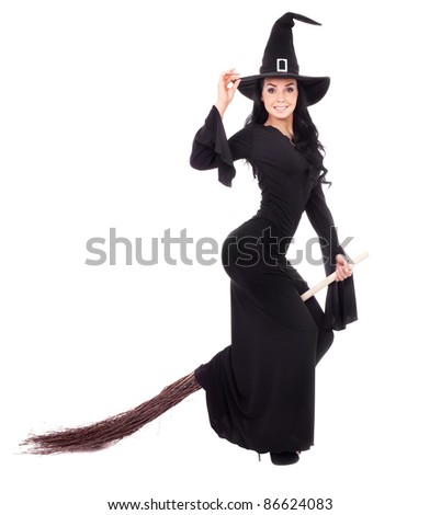 pretty  young brunette witch with a broom, isolated against white background