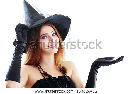 pretty young brunette woman dressed as a fairy or witch - stock photo