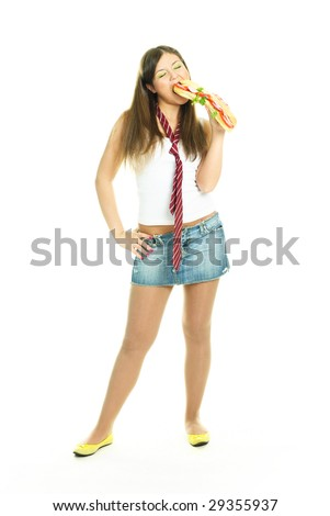 pretty young brunette woman eating a huge sandwich, isolated against white background - stock photo