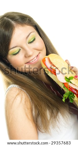 pretty young brunette woman eating a sandwich, isolated against white background - stock photo