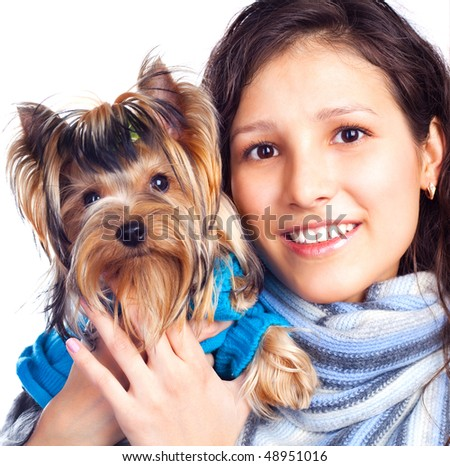 pretty young brunette woman with a dog in her hands