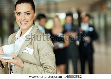 pretty young businesswoman having coffee during seminar break - stock photo