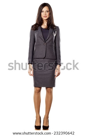 pretty young businesswoman posing on white background - stock photo