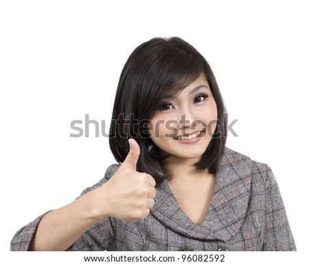 pretty young businesswoman thumbs up - stock photo