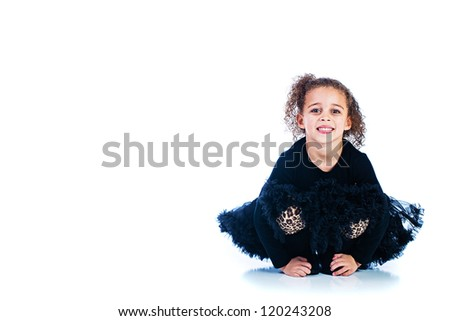 Pretty young child wearing a black dress