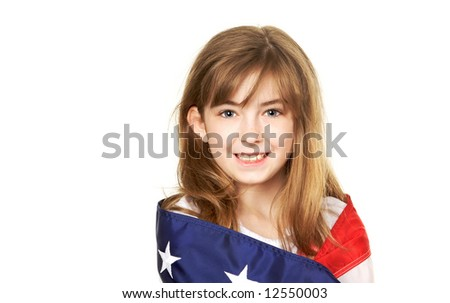 Pretty young child wrapped in a American Flag - stock photo