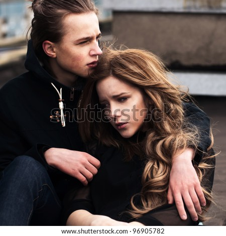 Pretty young couple embracing - stock photo