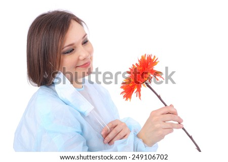 pretty young doctor with the red flower
