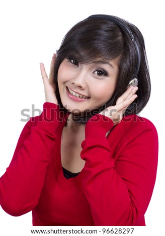 pretty young female listening to the music - stock photo