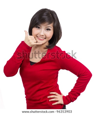 pretty young female making call sign with her hand - stock photo