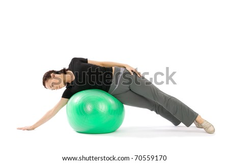 Pretty young fit woman practice with a pilates ball, isolated over a white background - stock photo