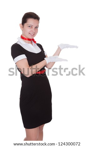 Pretty young flight attendant or hostess in a smart uniform isolated on white - stock photo
