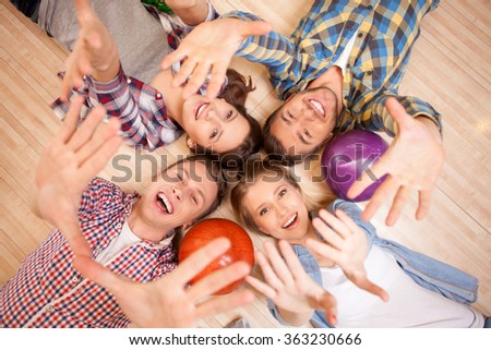 Pretty young four friends in kegling club - stock photo
