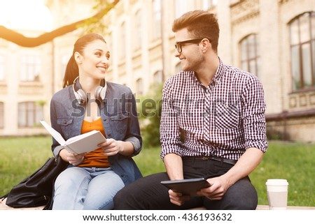 Pretty young friends are resting together outdoors - stock photo