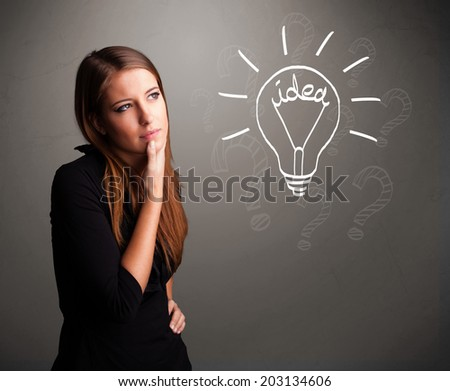 Pretty young girl comming up with a light bubl idea sign - stock photo