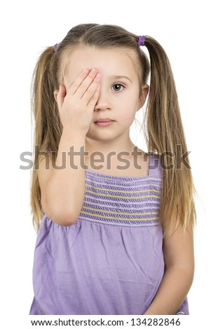 pretty young girl covering one eye with her palm for eye exam isolated on white background - optometry concept - stock photo