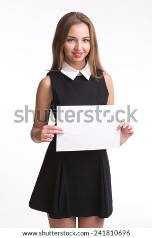 Pretty young girl hildong paper in studio isolated