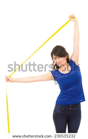 pretty young girl holding measuring tape with her arms extended above her isolated on white