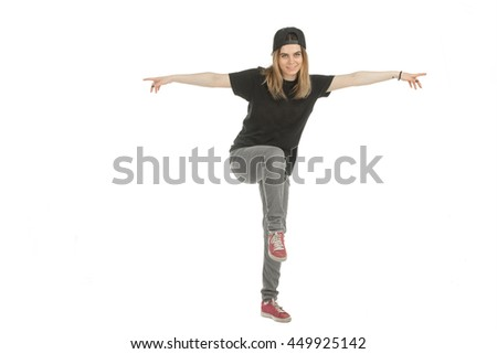 pretty young girl in casual clothes balance standing on one leg and smiling on camera isolated