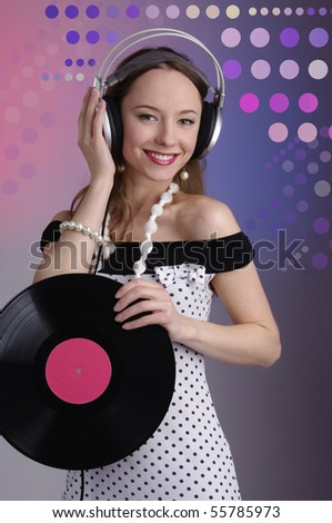 Pretty young girl listening music