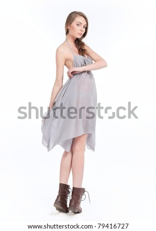 Pretty young girl model in the dress
