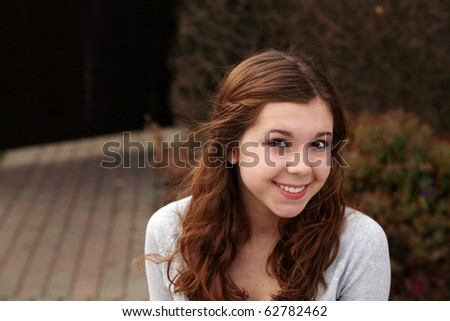 pretty young girl outside  smiling - stock photo